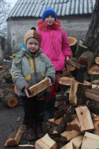 Ukrainian children with donated firewood