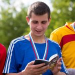 Young man with Scripture during the World Cup in Russia